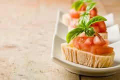 Bruschetta with tomatoes and basil Stock Photos