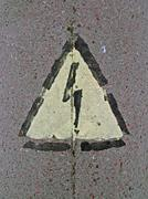 Electricity danger sign on stone surface, power details Stock Photos
