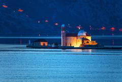 The old church in the sea at night Stock Photos