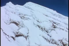 Aerial of Mount Rainer, POV, passing snow cliffs, Mount Rainer National Park Stock Footage