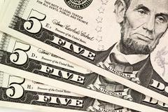 Five dollar bills Stock Photos