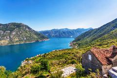 the old house with view on the sea and mountains - stock photo