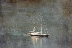 Yacht at sea in retro sryle Stock Photos