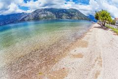 Stock Photo of sandy beach with sea and mountain