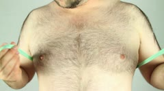 Average man measuring chest front on shot Stock Footage