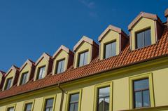 house top windows and roof - stock photo