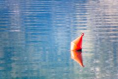 the red buoy in the sea - stock photo