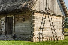 Wooden ladder leaning on a hut in the country Stock Photos