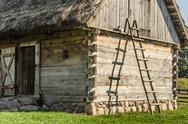 Stock Photo of wooden ladder leaning on a hut in the country