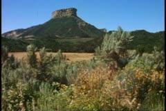 Desert mesa plateau, butte, tumbleweeds, Mesa Verde National Park, Colorado Stock Footage