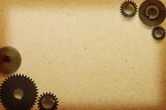 Gears on the old paper. Stock Photos