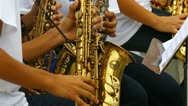 Young people playing saxo in band 2 Stock Footage