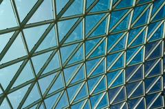 glass windows grid on blue sky - stock photo