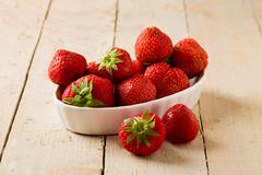 strawberries on wooden table - stock photo