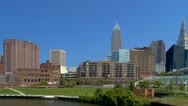 Passing by Cleveland skyline while sailing Cuyahoga river Stock Footage