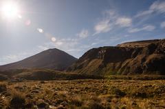 Stock Photo of mount ngauruhoe with sun glare, tongariro national park, new zealand