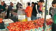Two Shoppers Pick out Tomatoes Stock Footage