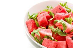 Stock Photo of watermelon and arugula salad isolated