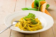 Pasta with saffron and arugula pesto Stock Photos