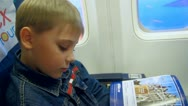 Stock Video Footage of child, boy in an airplane, flying, travel, vacation, tourism