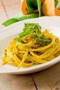 Stock Photo of pasta with saffron and arugula pesto