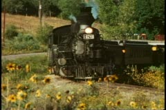 Durango Silverton Railroad, passby on curve, locomotive, cars, Durango, Colorado Stock Footage