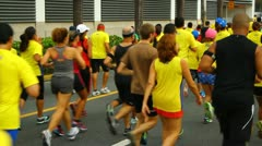 People running and walking in race marathon Stock Footage