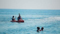 boat, kayak, vacationers, sea, tourism - stock footage
