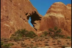 Arches National Park, Moab, Utah, medium shot, small arch Stock Footage