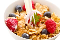 Stock Photo of corn flakes with berries - isolated