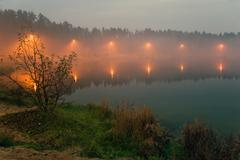 Foggy lake Stock Photos