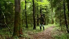 Forester walking in the forest, young man Stock Footage