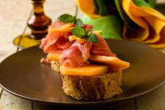 ham and melon appetizer - stock photo