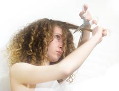Stock Photo of girl cutting hair
