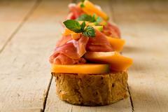 Ham and melon appetizer Stock Photos
