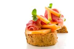 Stock Photo of ham and melon appetizer isolated