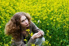girl in the yellow flowers field - stock photo