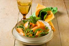 melon and arugula salad - stock photo
