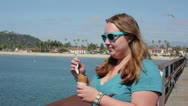 Woman eating ice cream while overlooking the ocean Stock Footage