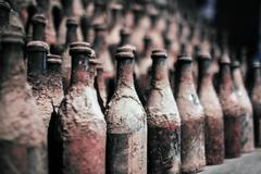 Old wine bottles covered with dust Stock Photos