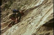 Mountain climbing school, girl climbs rocks face, Grand Teton National Park Stock Footage
