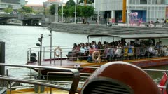 River cruising preparing to leave jetty - stock footage