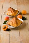 croissants with apricot marmalade - stock photo
