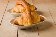 Croissants on wooden table Stock Photos