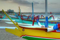 Traditional jukung boats Sanur Bali - stock photo