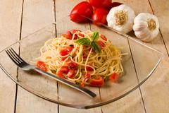spaghetti with garlic and oil - stock photo