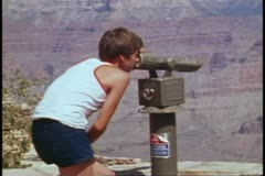 The Grand Canyon, boy looking through telescope, medium shot Stock Footage