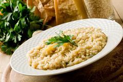 risotto with grana parmesan cheese - stock photo