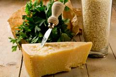 ingredients for risotto with grana cheese - stock photo