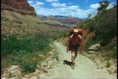 The Grand Canyon, hikers, one walking up and out, wide shot, weary Stock Footage